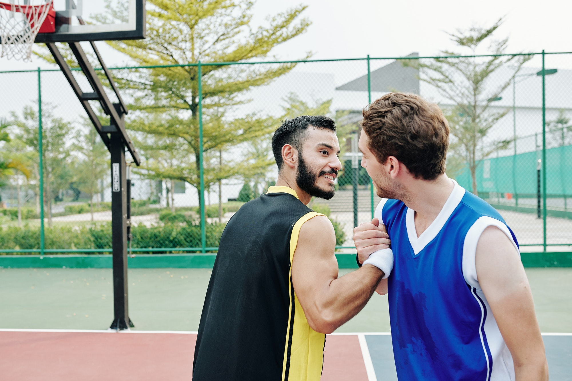 Basketball players shaking hands