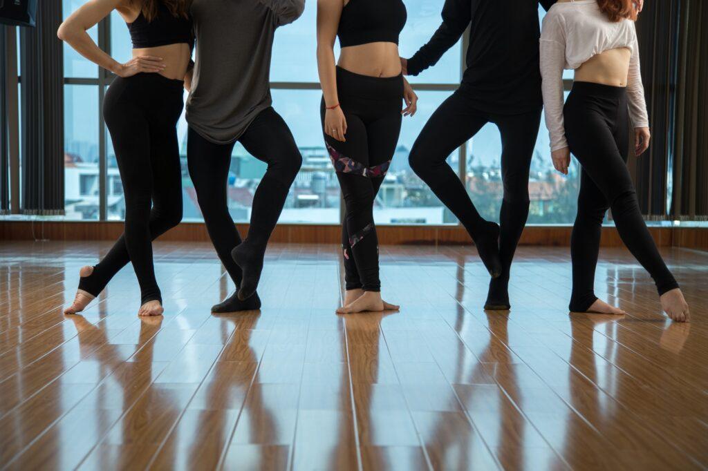 Crop dancers standing in studio